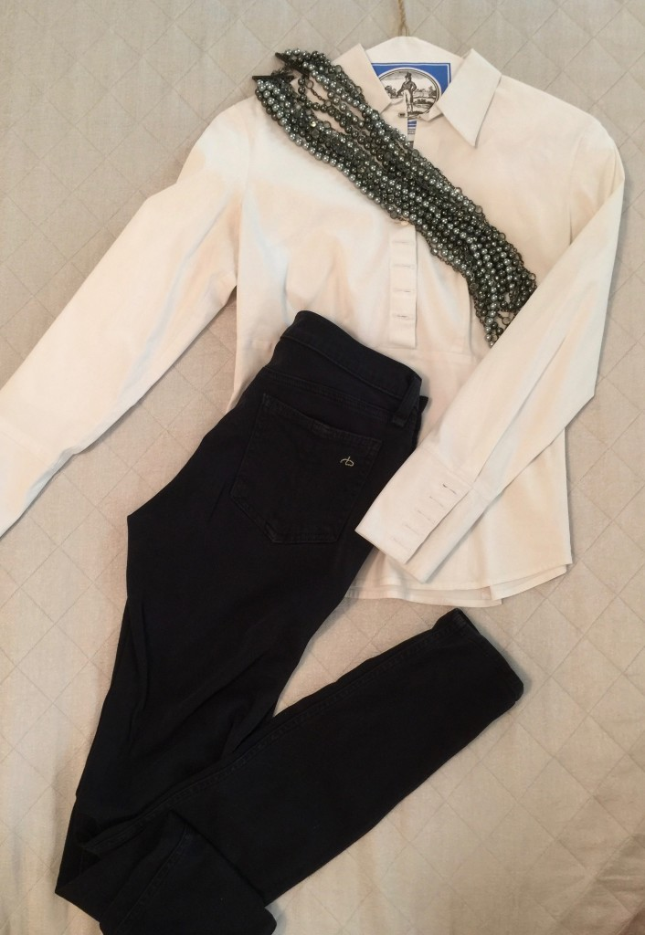 white shirt, black jeans, business look.